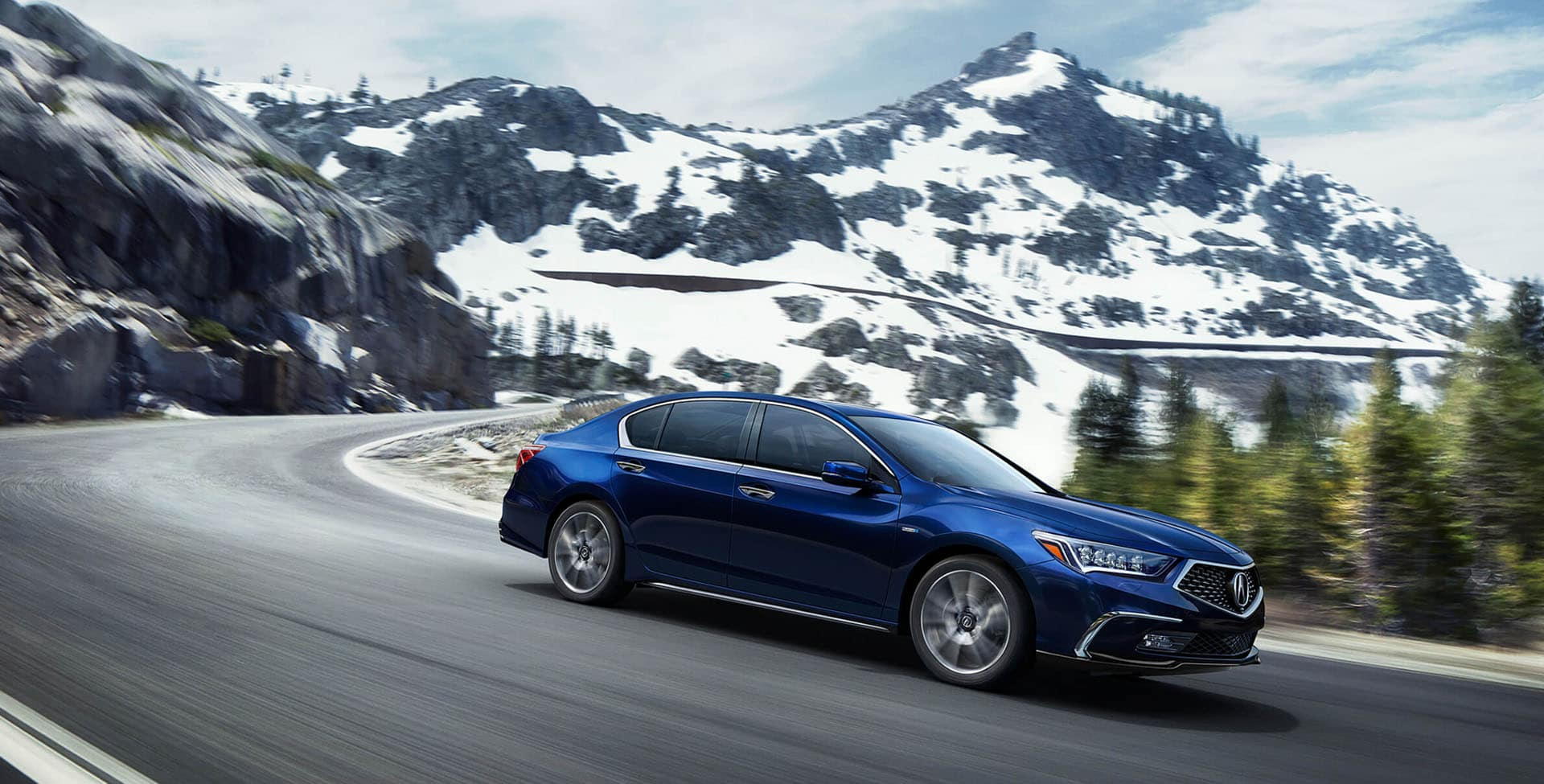 Blue Acura RLX driving through the mountains