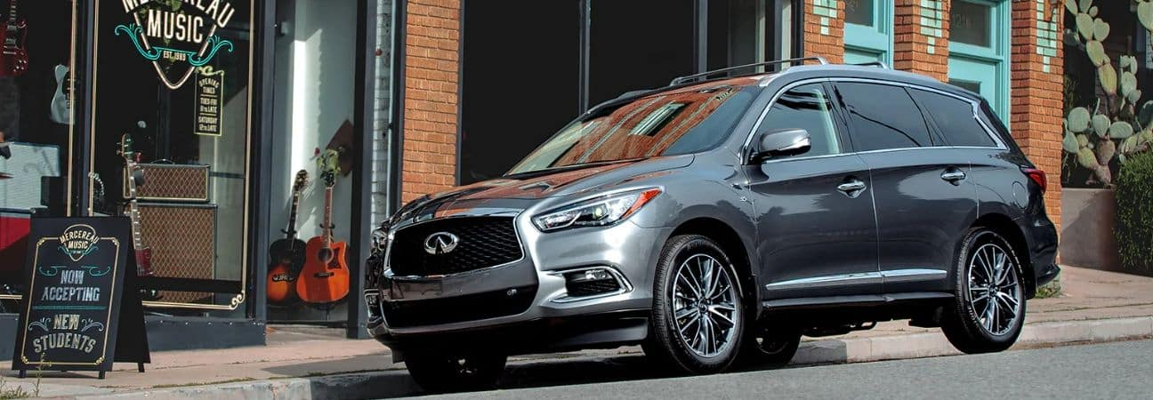 2020 INFINITI QX60 parked in front of music store