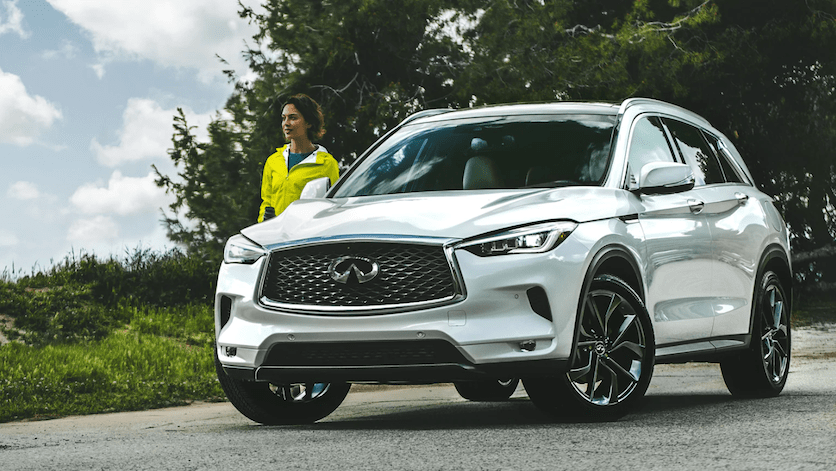 A woman exiting her 2020 INFINITI QX50