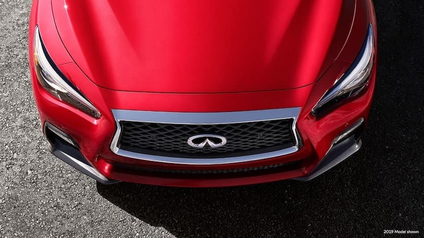 A top-down view of the INFINITI Q50 RED SPORT 400 hood, LED headlights, and grille design
