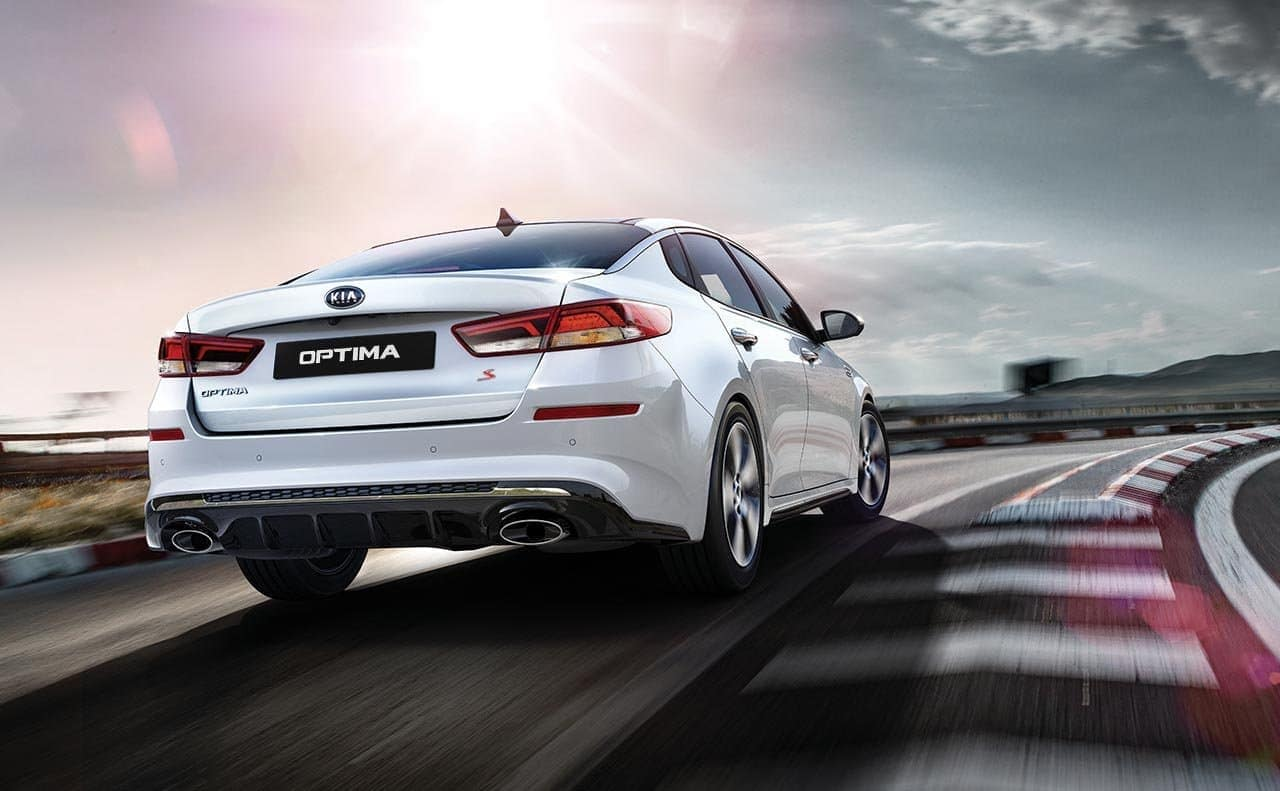 2019 Kia Optima S in white racing down track