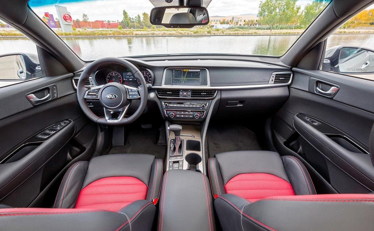 2019 Kia Optima interior front passenger view with technological dashboard instruments