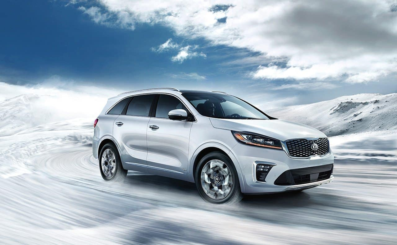 2019 Kia Sorento driving down curved icy road