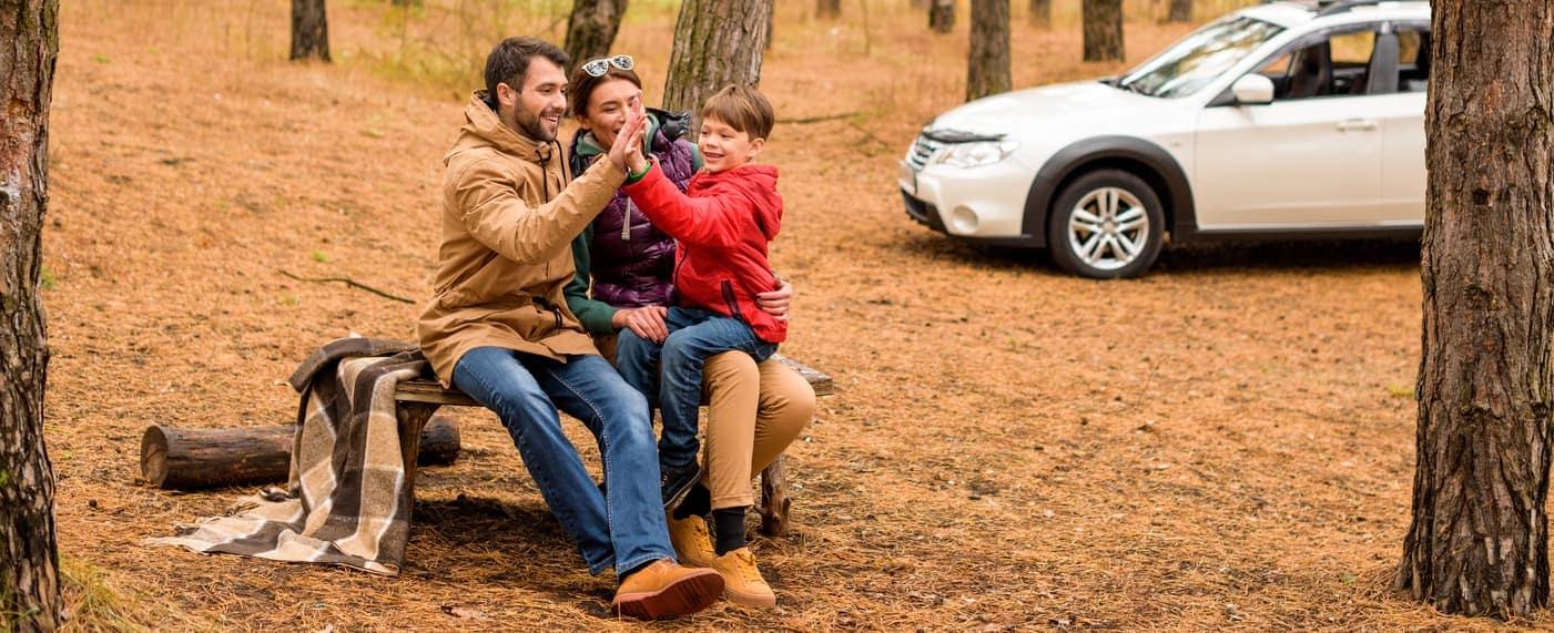 family in woods having fun