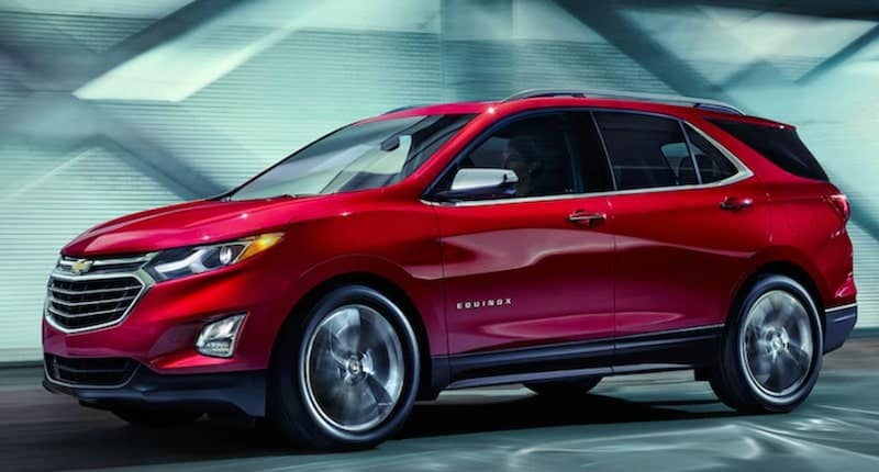 Red 2019 Chevrolet Equinox Leaving Trails