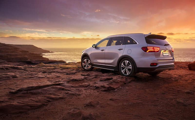 Kia Sorento parked on top of a hill at sunset