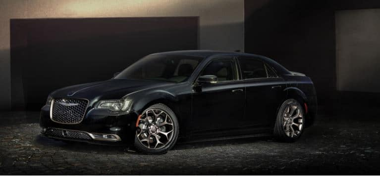 black chrysler 300 with spotlight on it
