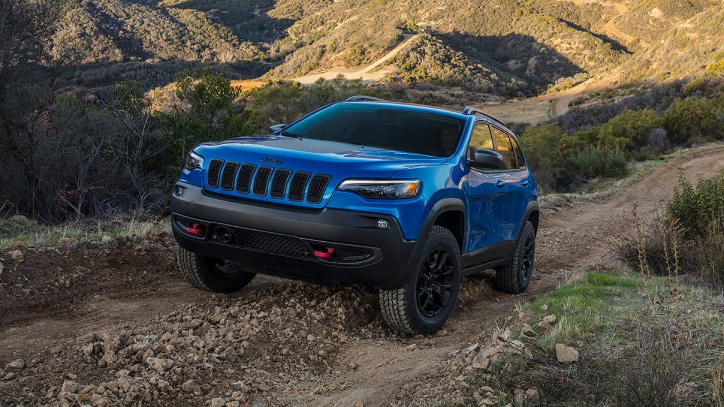 blue jeep cherokee on trail