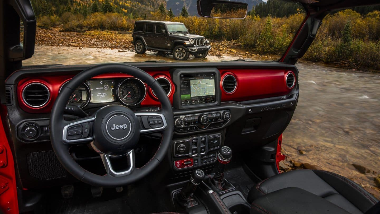 jeep wrangler interior while one jeep is mudding