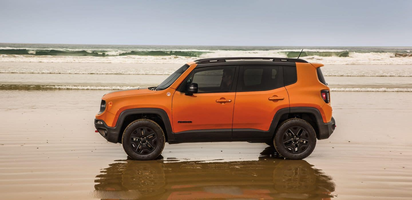 orange jeep renegade on beach