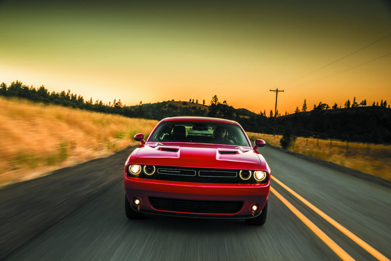 red dodge challenger moving across high