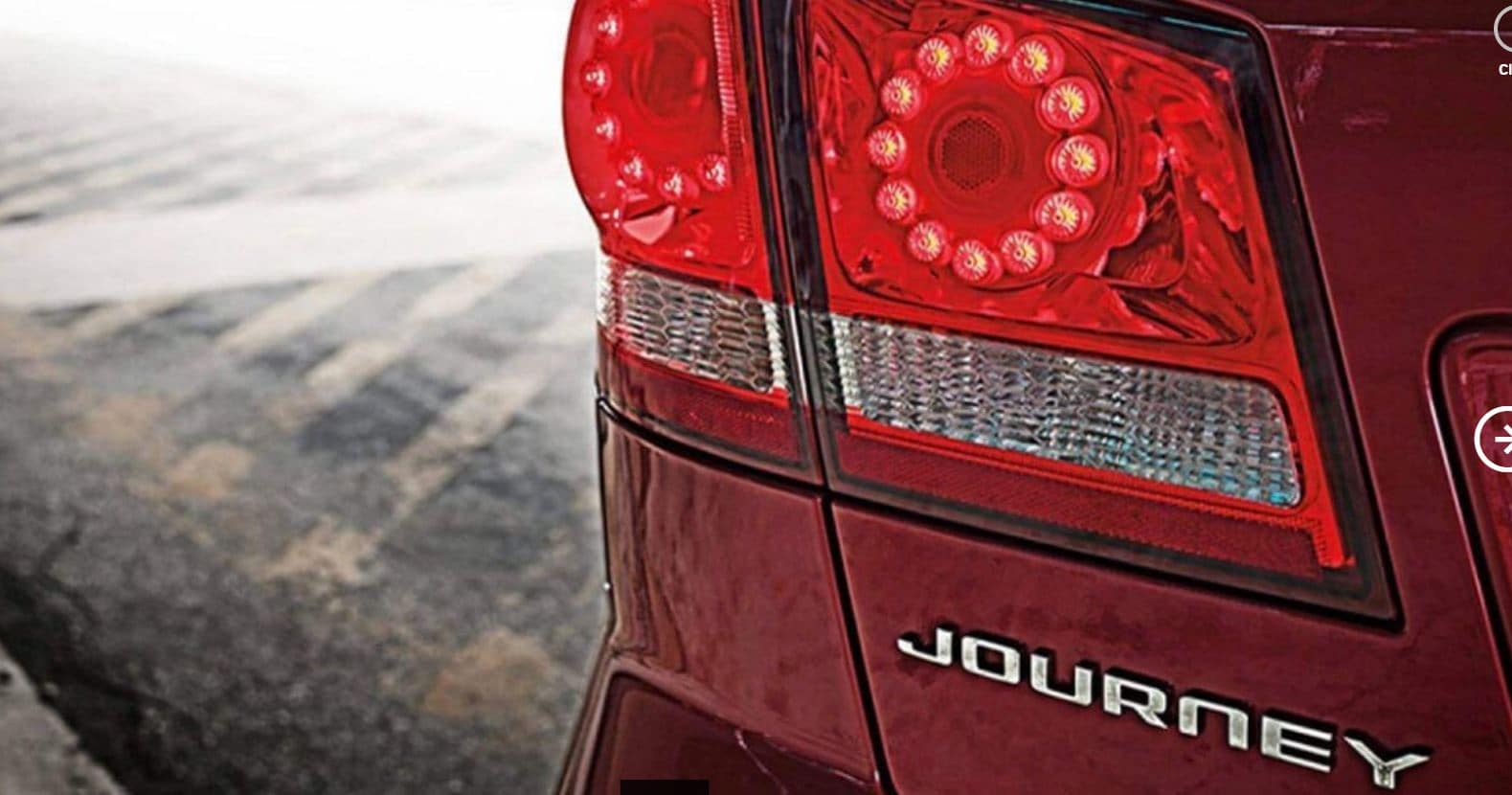 red dodge journey rear taillight and text that reads journey with rear taillights lit