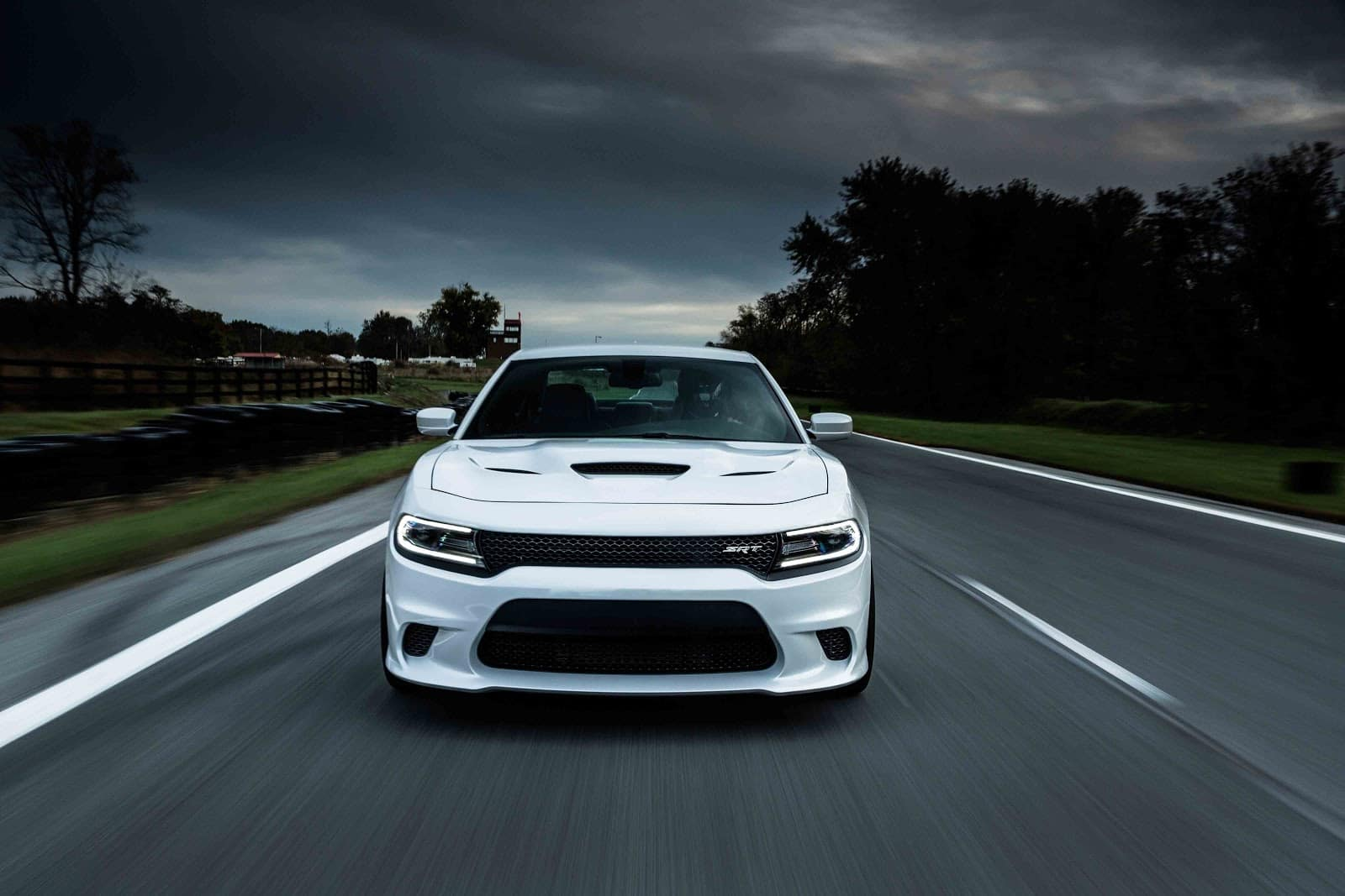 white 2019 dodge charger driving down highway