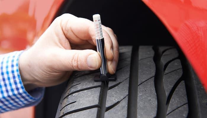 Check tire tread depth gauge at Hello Nissan of Valencia near Santa Clarita, CA and Los Angeles Metro Area