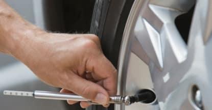How to check tire pressure with tire pressure gauge at Hello Nissan of Valencia near Santa Clarita, CA and Los Angeles Metro Area