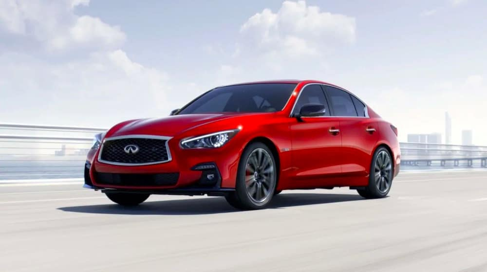 2019 INFINITI Q50 in red in the city