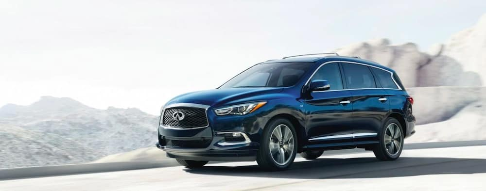 2019 INFINITI QX60 in black in the mountains
