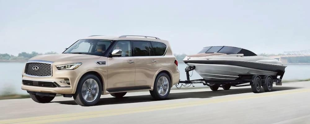 2019 INFINITI QX80 towing a boat