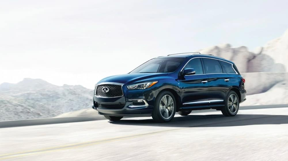 2019 INFINITI QX60 in dark blue in the mountains