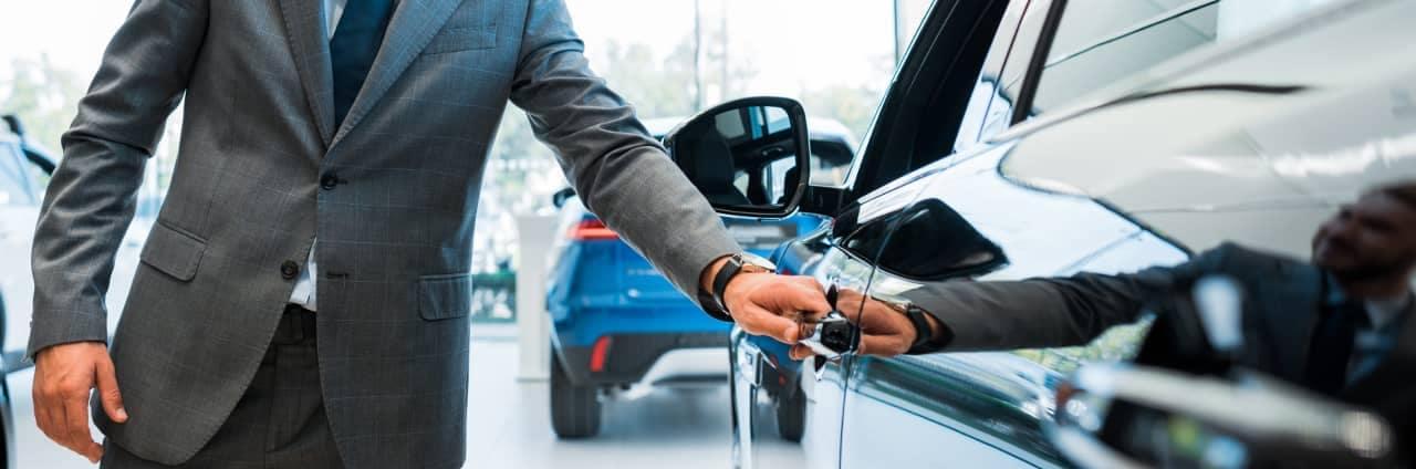 man holding a car door handle