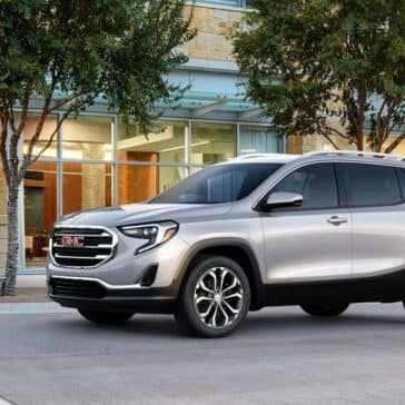 2019 GMC Terrain parked by house