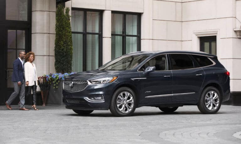 2021 Buick Enclave exterior with couple walking towards vehicle