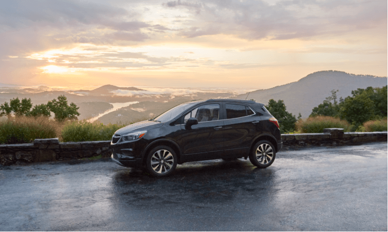 2021 Buick Encore exterior overlooking mountains at sunset