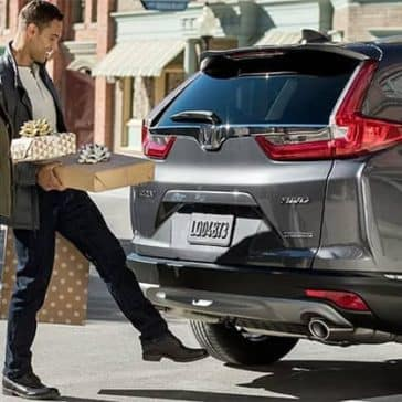Couple-Loading-Presents-into-2019-Honda-CR-V-Cargo-Area