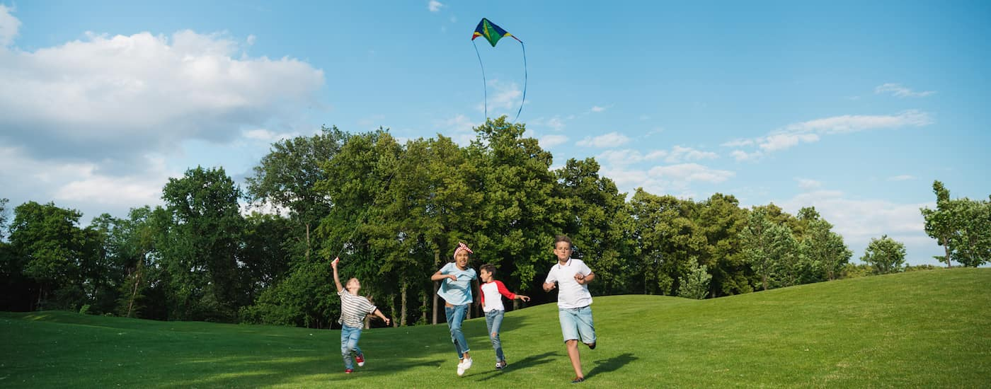 Children flying a kite in a park