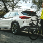 2021 INFINITI QX50 Parked with Biker