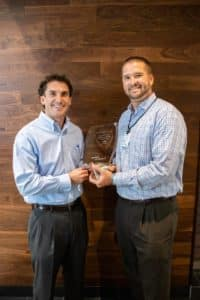 Ty Bullard and Sean Gleason with INFINITI Award of Excellence Trophy