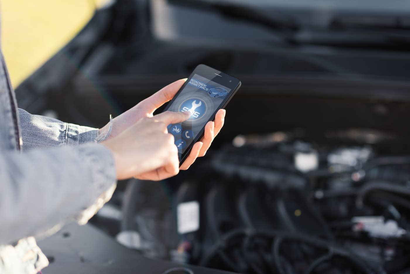 Contacting roadside assistance through phone application