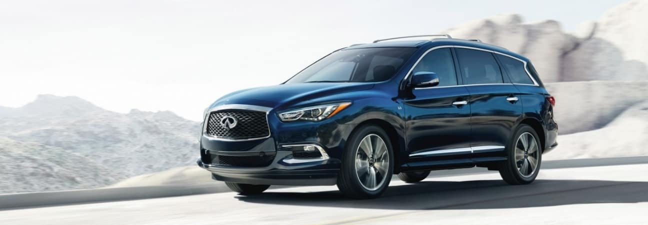 2019 INFINTI QX60 SUV driving down the road