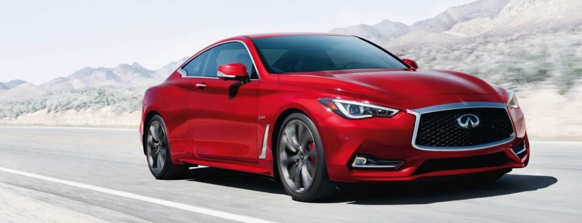 Red 2019 INFINITI Q60 traveling through desert