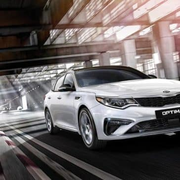 2019 Kia Optima driving white