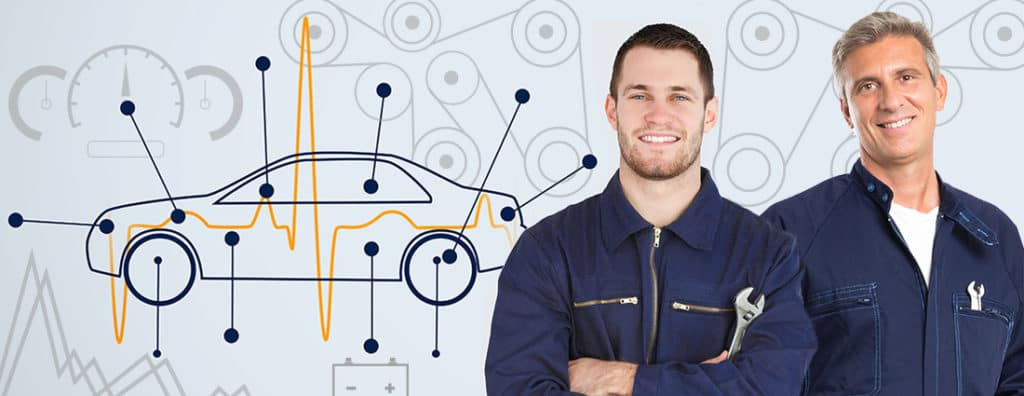 professional repair technicians in front of a diagram of a car