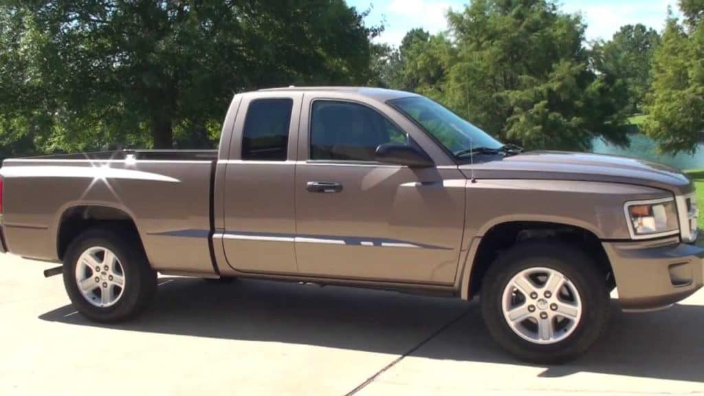 a picture of a 2010 Dodge Dakota sitting on a driveway in Edmond Oklahoma