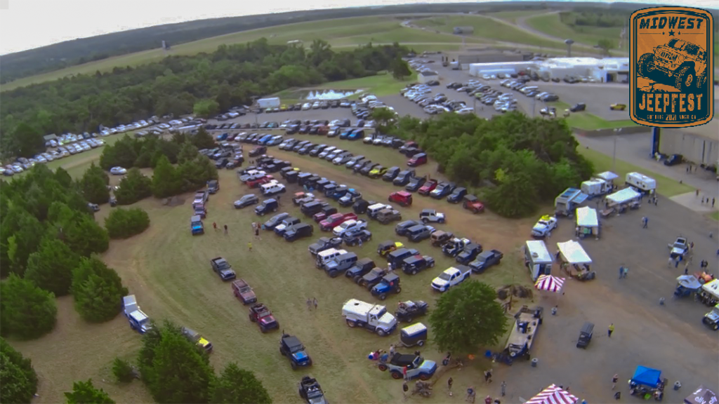 a large amount of jeeps parked together in a field in Guthrie, Oklahoma