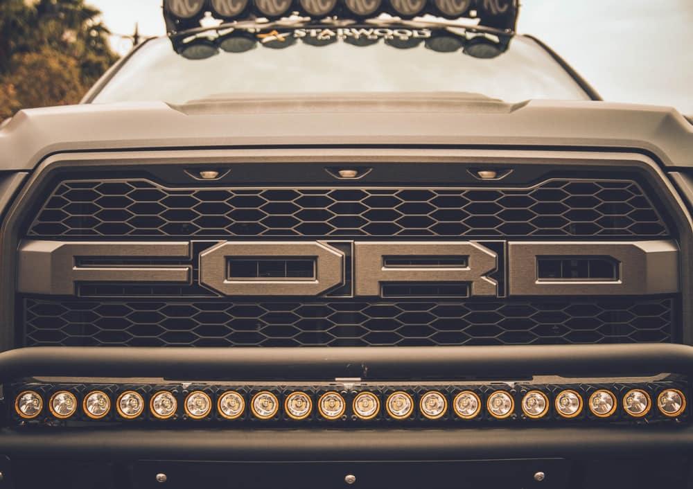 a closeup shot of headlights on a truck