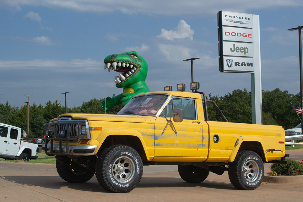 """a jeep used in the filming of """"Twister"""" the movie in front of John Vance Chrysler Dodge Jeep Ram in Guthrie, Oklahoma."""
