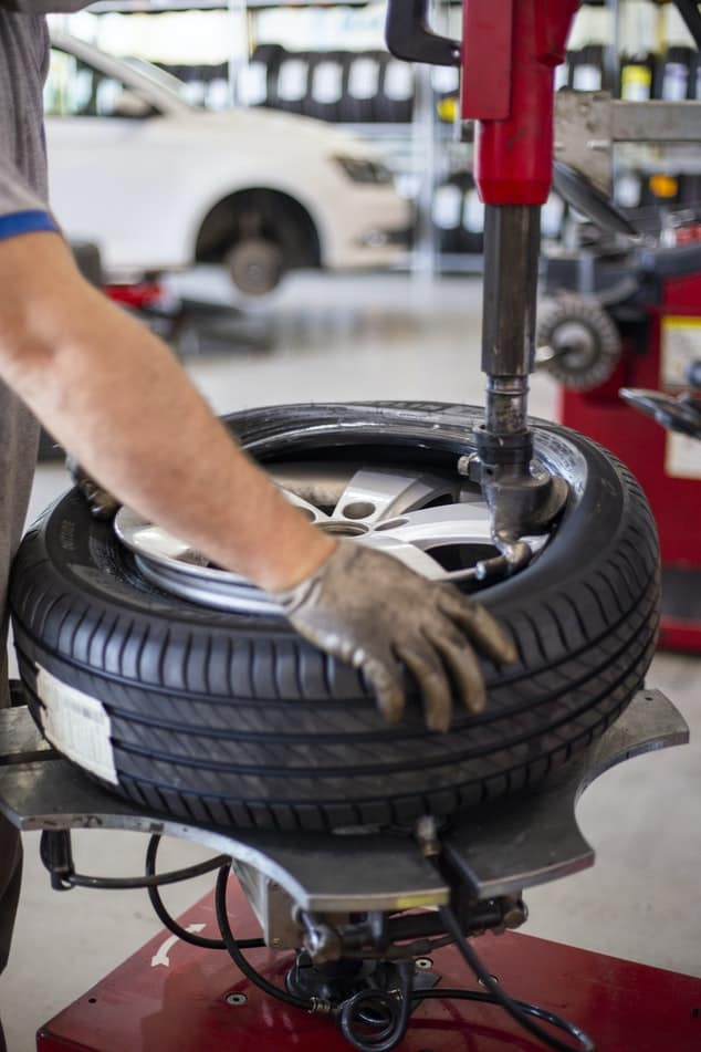 a new tire being put on a wheel at an edmond tire shop
