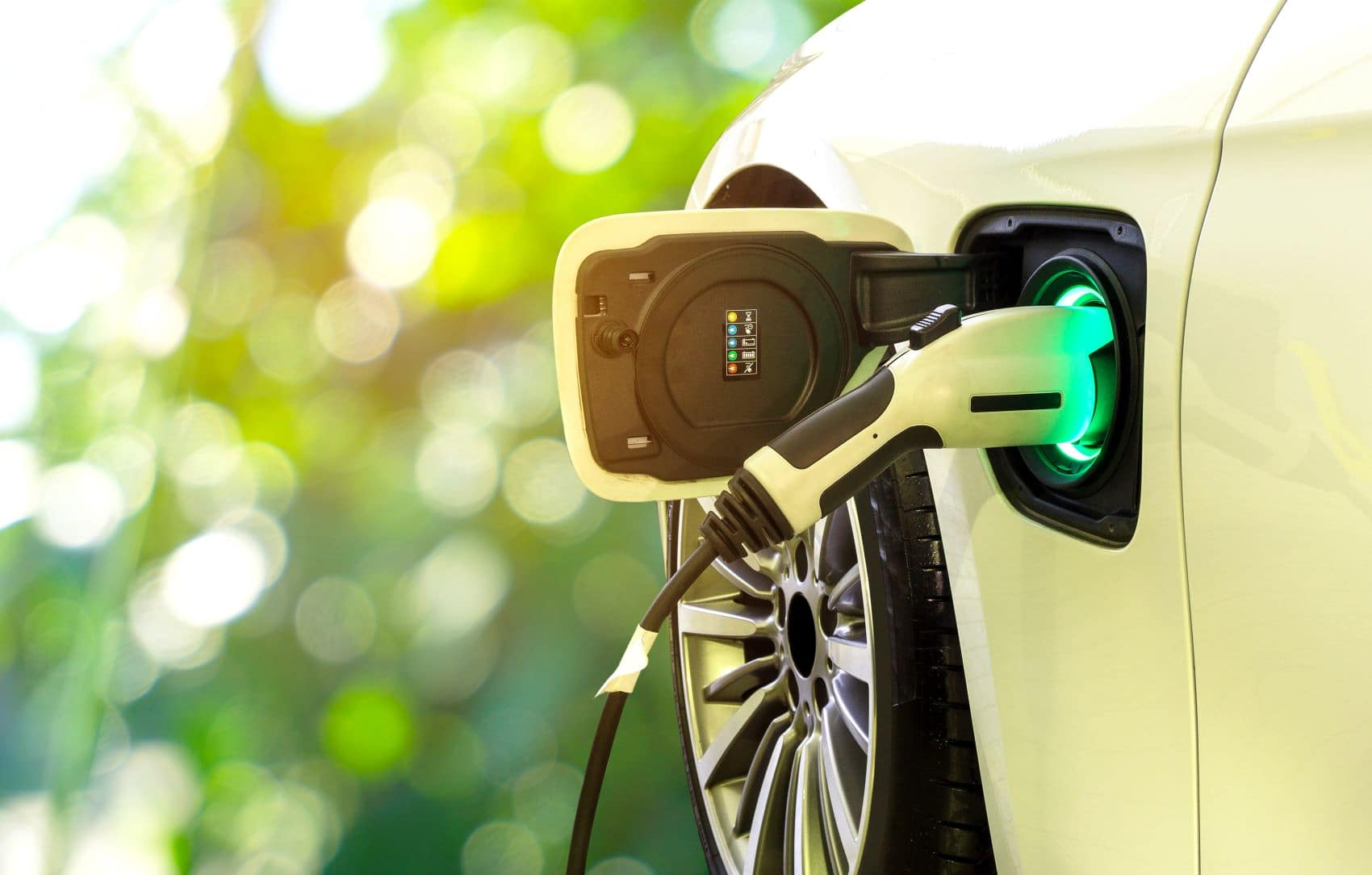 Electric vehicle charging at a clean fuel charging station