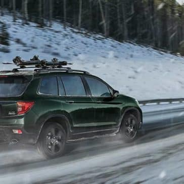 2019 Honda Passport on snowy mountain road