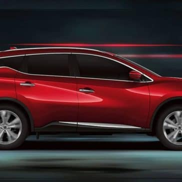 Red 2020 Nissan Murano blurred background side view