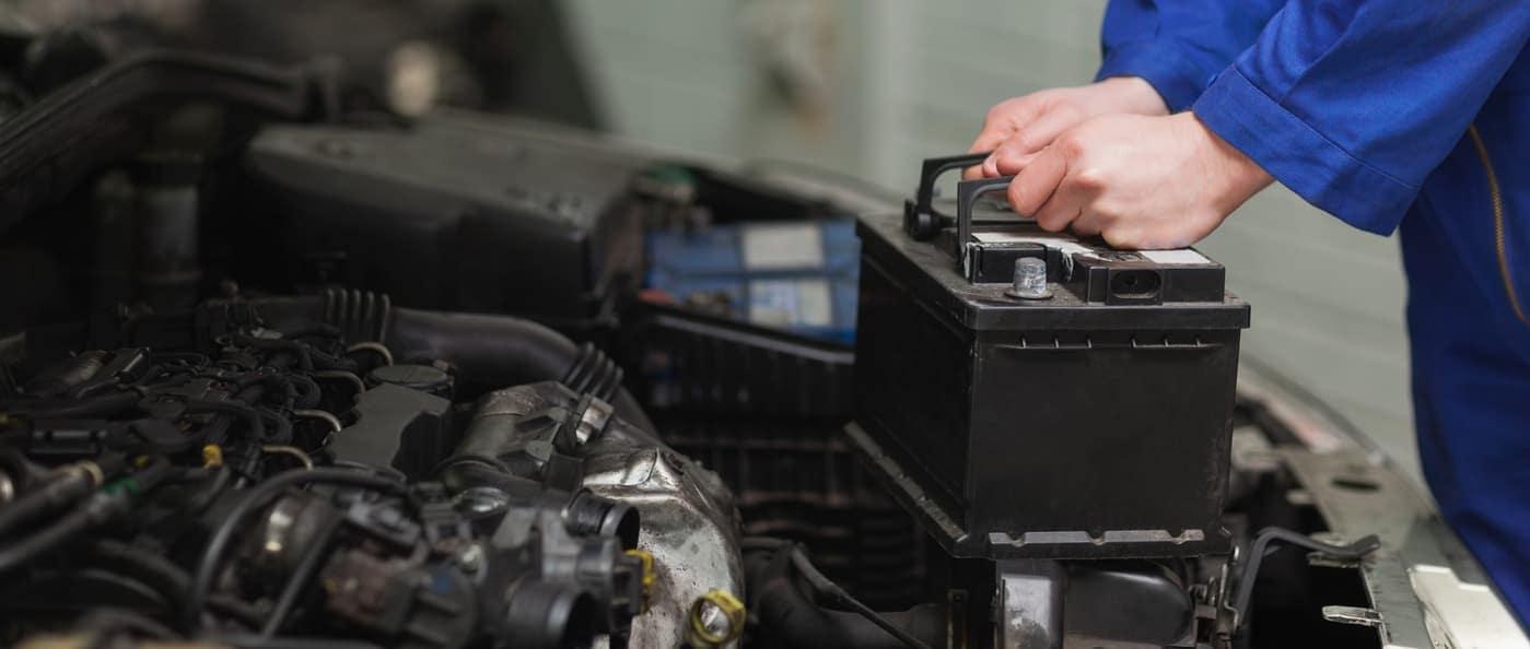mechanic replacing car battery