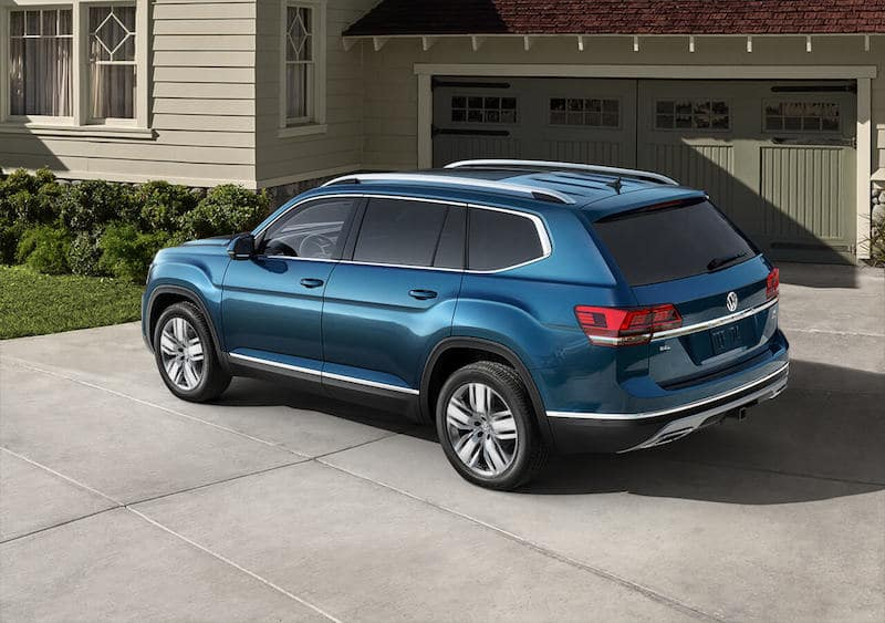 Blue Volkswagen Atlas parked in a driveway