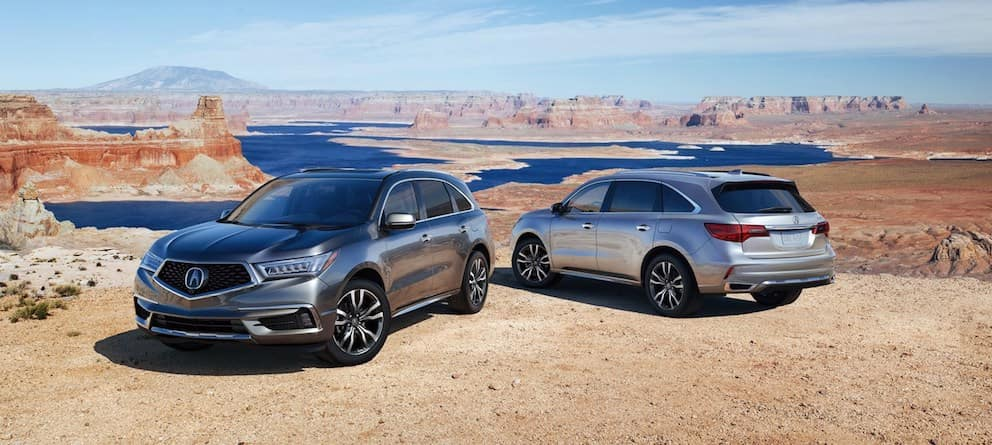 Two Acura MDX SUVs Parked in a Desert