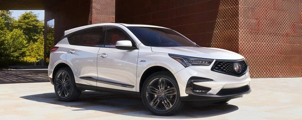 2020 Acura RDX white near driveway