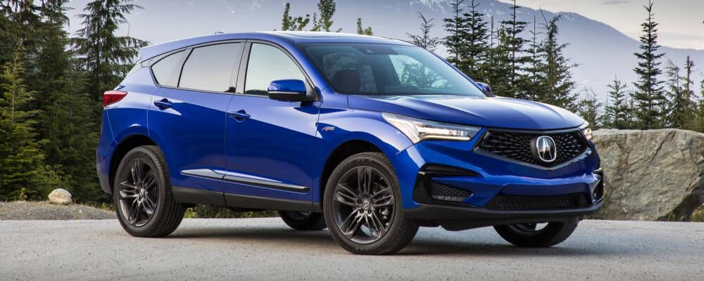 2021 Acura RDX parked near forest