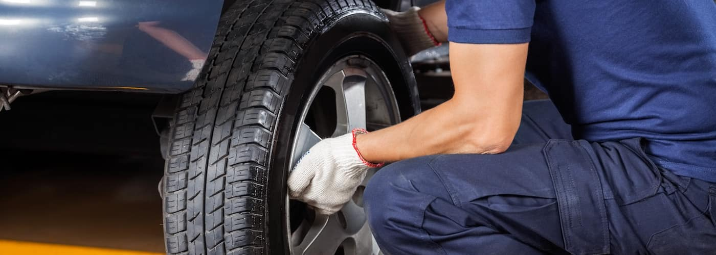 Changing tire in a service shop